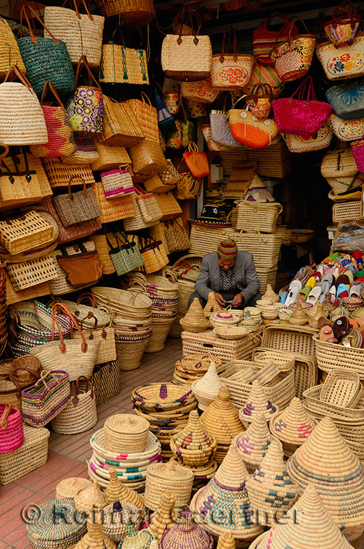Shopkeeper selling basket weaving bags and containers in Casablanca new outdoor market