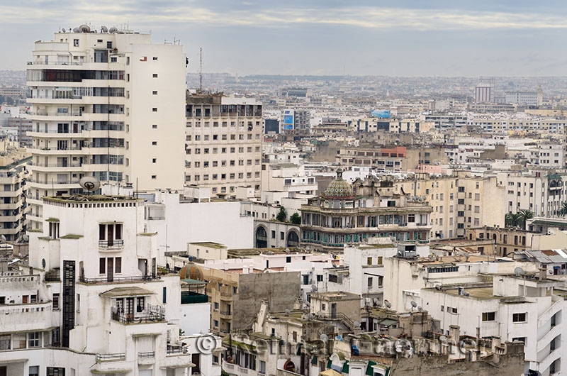 Zoomed view of the white hazy Casablanca cityscape with clouds