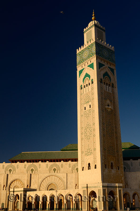 Minaret of the Hassan II Mosque in Casablanca Morocco at sunset