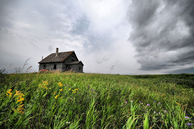 Summer  Storm Clouds and Old House Tyvan SK.