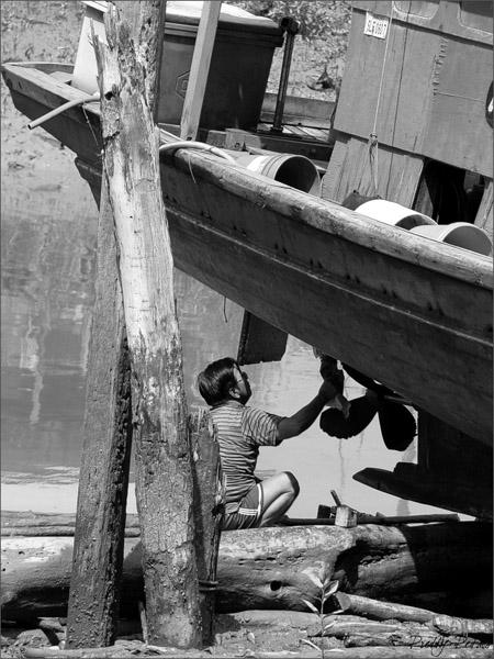 A Fisherman Fixing His Boat I