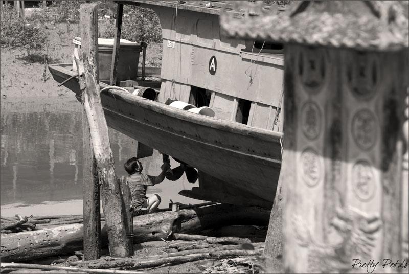 A Fisherman Fixing His Boat II