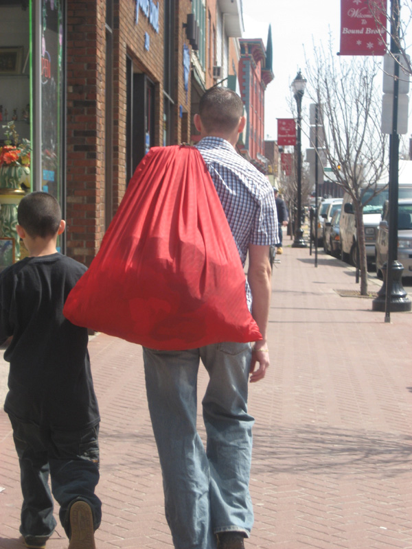 on the way somewhere with a big red bag.