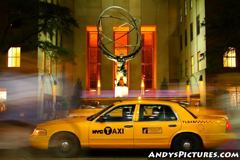 NYC Taxi stops in front of the Atlas Statue