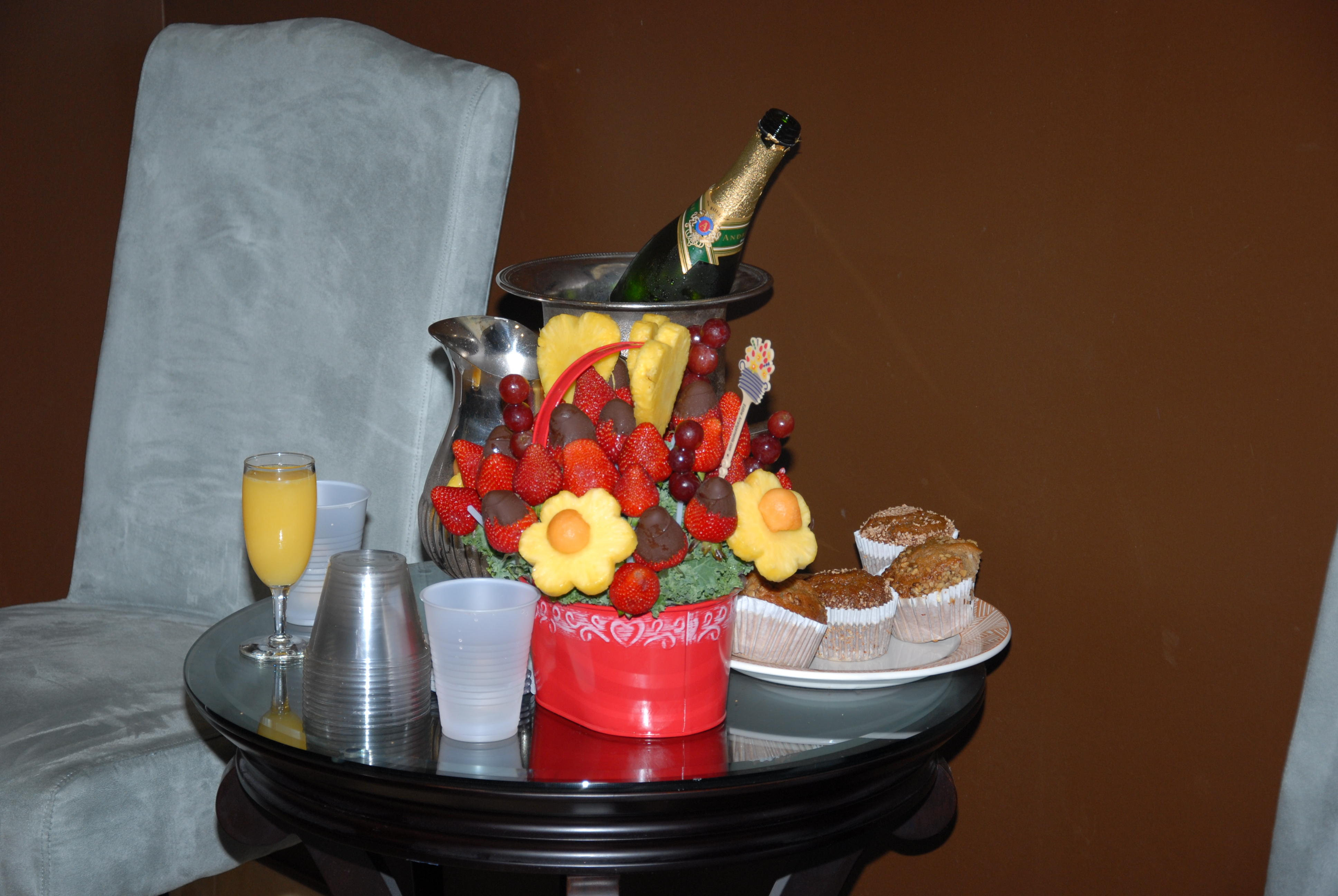 Fruit, muffins, orange juice and champagne!