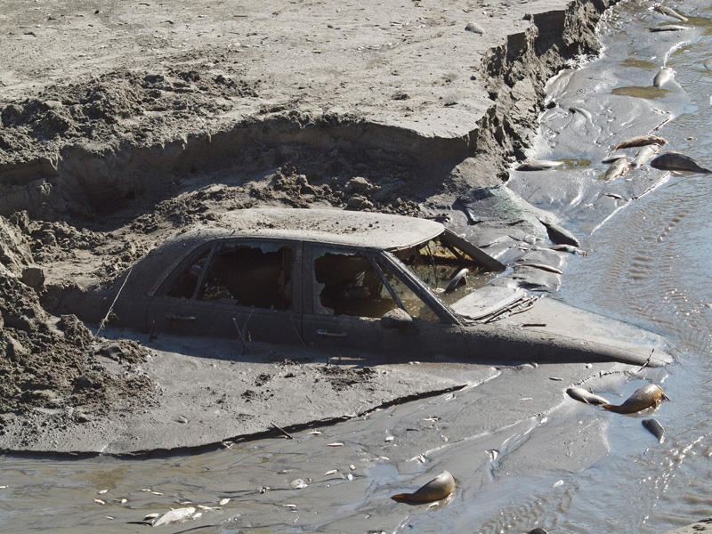 An old car in the waterway
