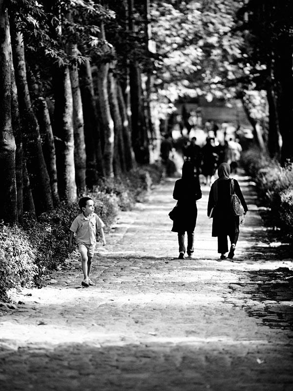 Boy walking in park - Tehran