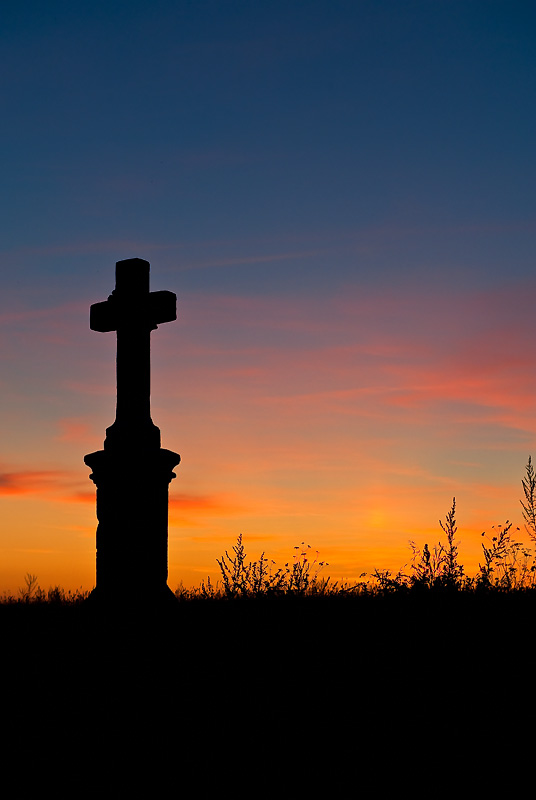 Stone Cross At Sunset