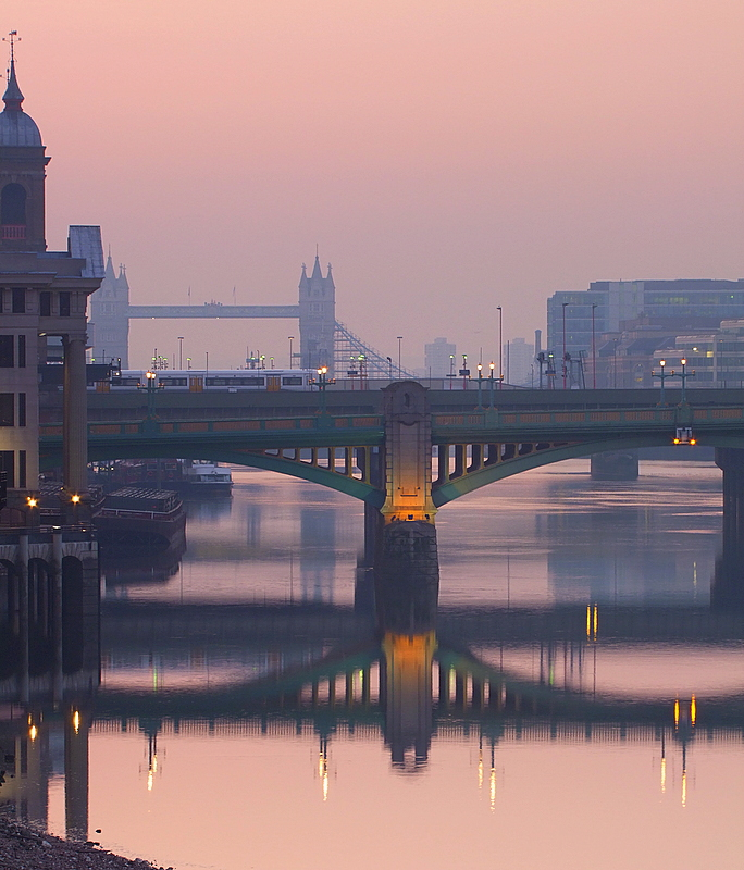 Trains,barges and bridge reflections in the dawn