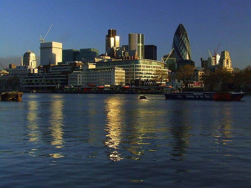 City towers reflecting the sunrise.