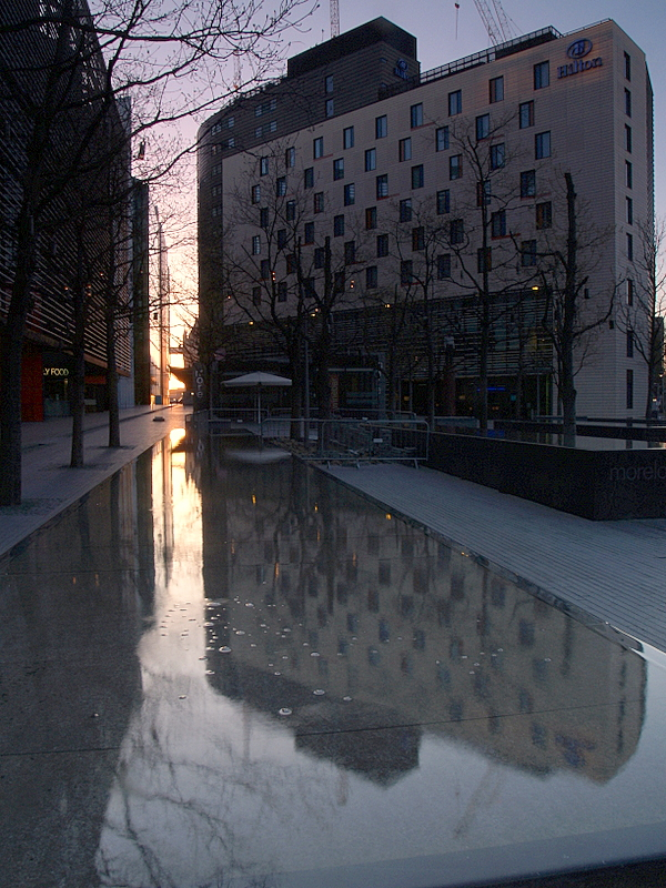 Hilton Hotel,SE1,reflected in unusual flat fountain.