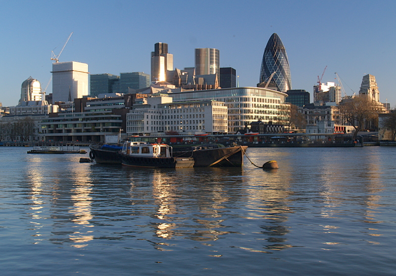 City of London in the sunrise,reflected.