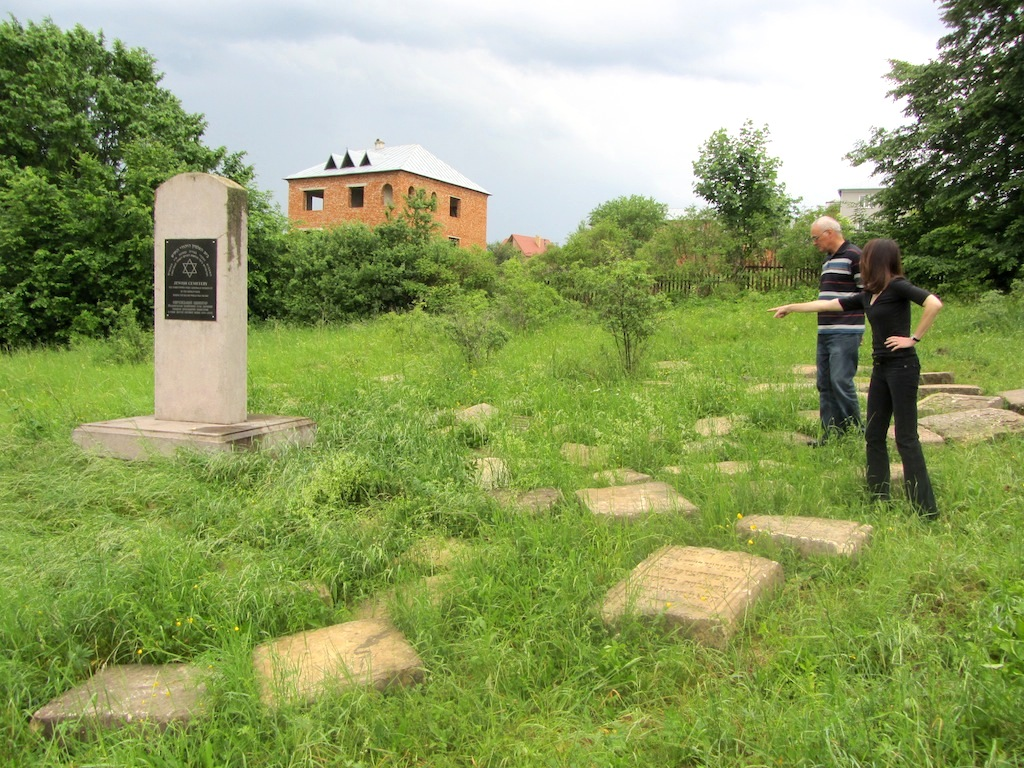 we reach Rohatyn as evening falls and make a quick stop at the new cemetery; Alex and Marla survey the area