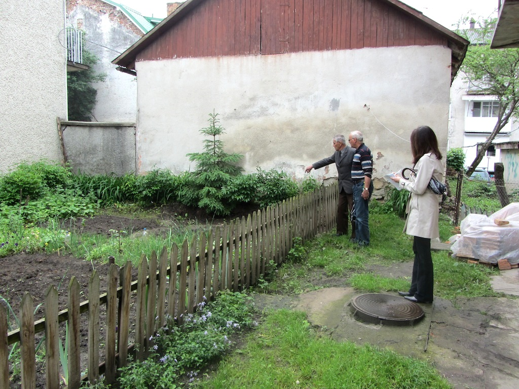 the next day, we meet with Abram Lyons and Mr. Vorobets to review the headstone work