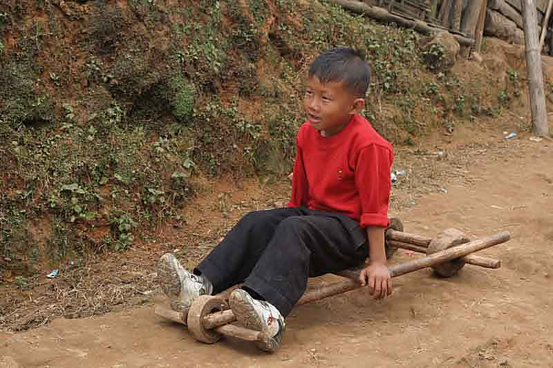 Boy with a typical Naga toy in Wanching.