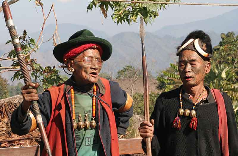 Former headhunters singing old war songs in Shangnyu.