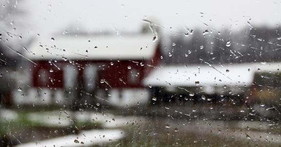 barn through a rainey window