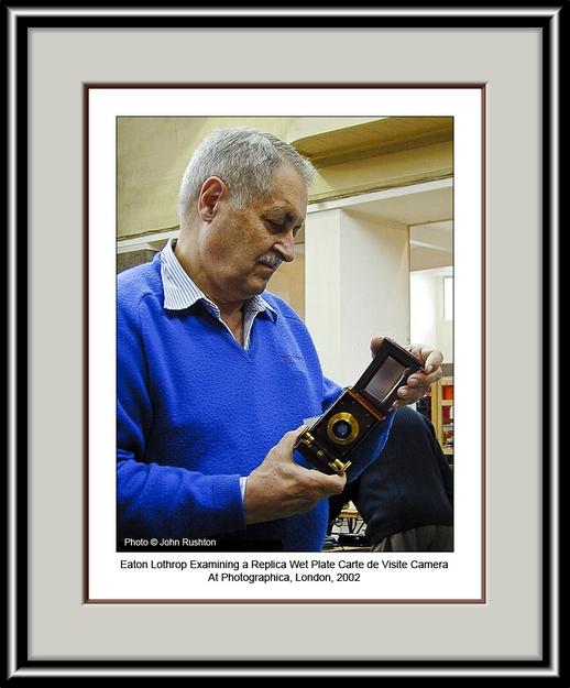 Eaton Lothrop Examining a Replica Carte de Visite Wet Plate Camera at Photographica 2002 edits framed.jpg