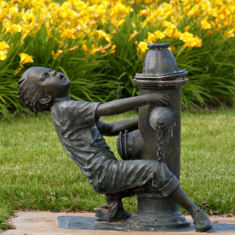 Boy and a Fire Hydrant Sculpture- one of several sculptures here and there.
