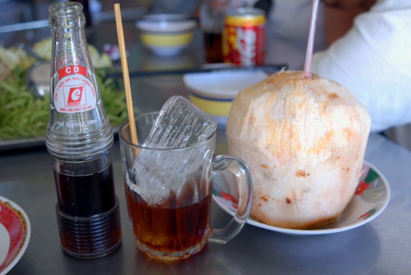 Local coca-cola and coconut juice
