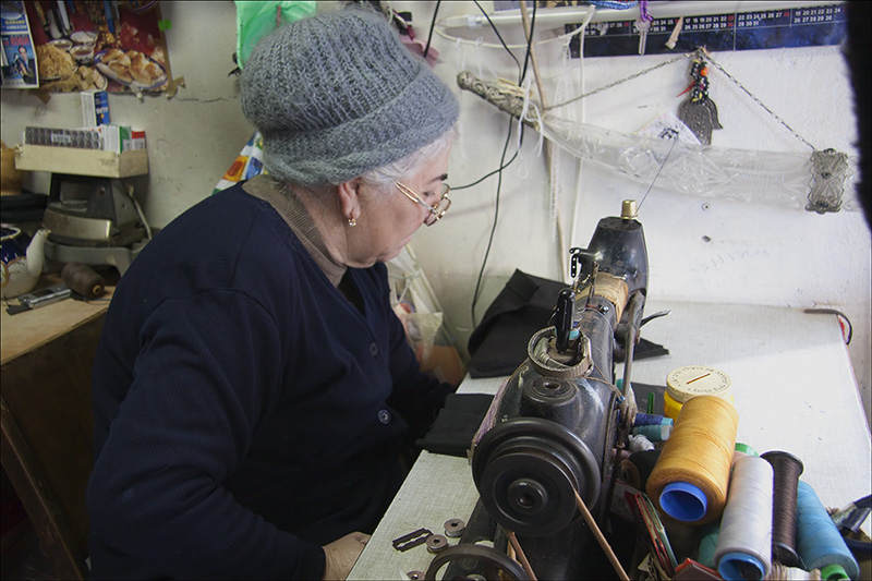 The Seamstress with a pre-war Singer Sewing Machine