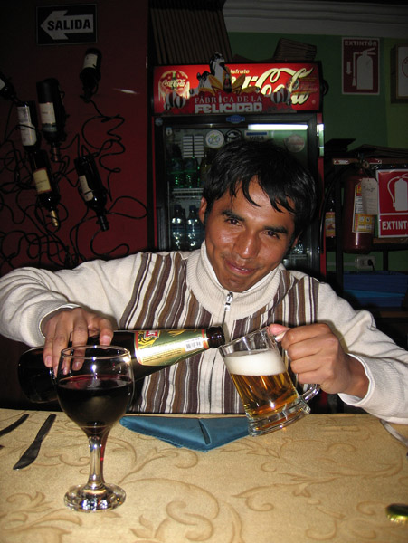 Marcos pouring a beer, Puno