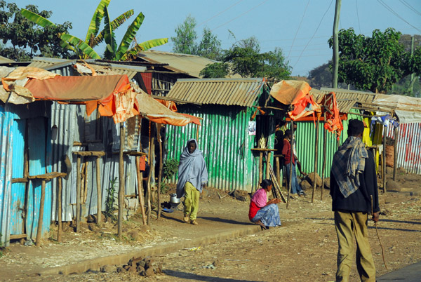 Shops set up in tin shacks along the road