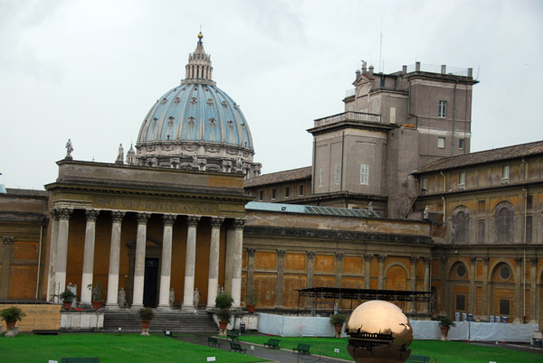 Courtyard of the Vatican Museum with the dome of St. Peters and the sphere