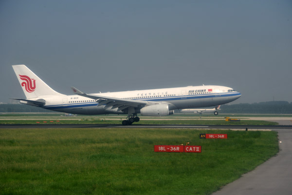 A great landing by an Air China A330 (B-6131) as we taxi for departure at PEK