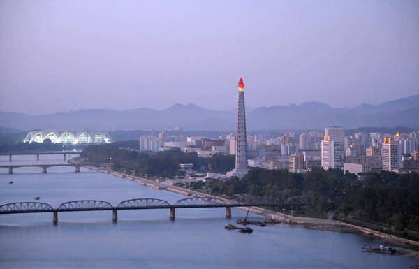 Juche Tower illuminated at dusk, Pyongyang