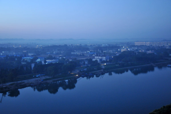 Still waters of the Taedong River at dawn
