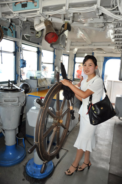 Kim Song Sim driving the boat