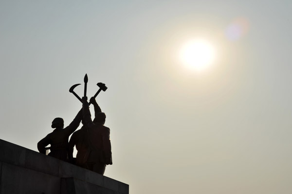 Statue at the base of Juche Tower - farmer, worker, intellectual