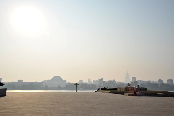 Looking across the plaza around Juche Tower to Kim Il Sung Square