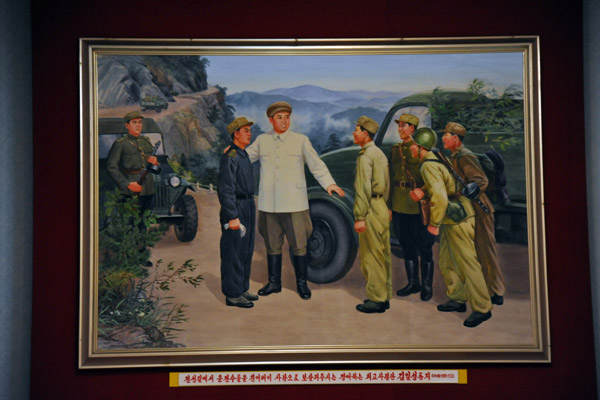 General Kim Il Sung with ammunition supply trucks crossing a mountain pass, 23 Sept 1951
