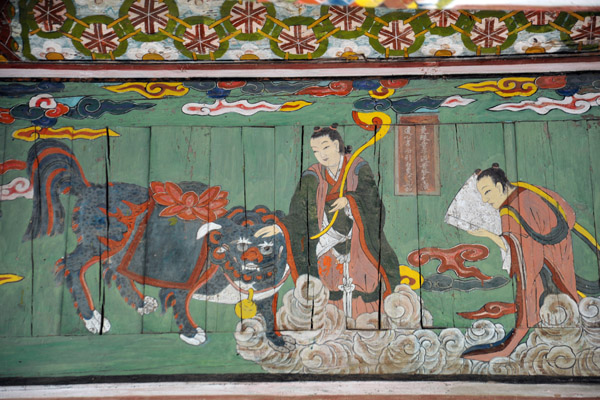 Bodhisattva petting the mythological haetae, a Korean fire-eating dog which resembles a lion