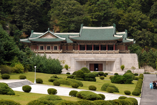 Like the Kim Il Sung hall, the building is merely the entrance to a complex of chambers carved out of the mountain