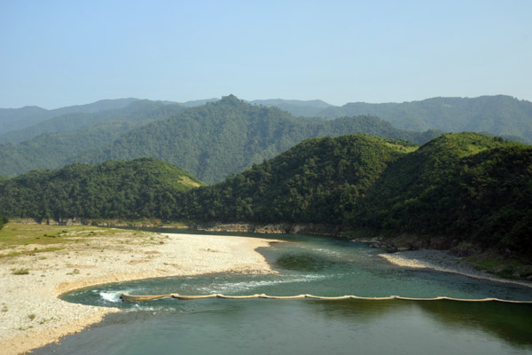 A small dam on the Chongchon River which diverts water through a tunnel to a hydroelectric plant