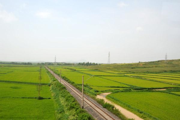 Railroad and rice paddies, South Phyongan Province, North Korea
