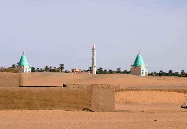 Minaret with a pair of elaborate green-domed tombs near Abu Dom