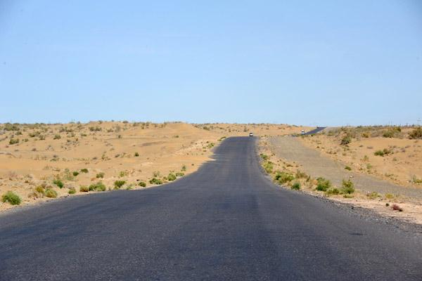 Road across the Karakum Desert between Mary and Türkmenabat