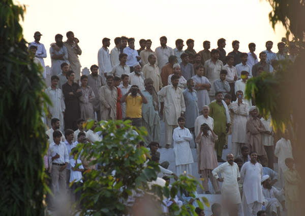 Theres a much smaller crowd on the Pakistan side with the men segregated from the women and children