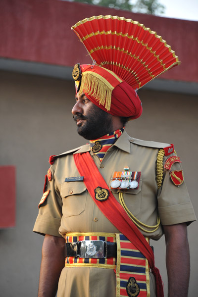 The officer in charge of the ceremony on the Indian side