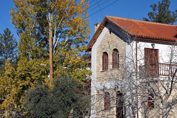 Stone house in Mandria with a red tile roof - autumn in Cyprus