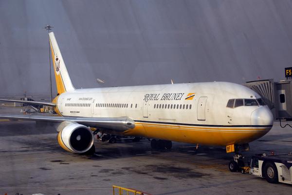 Royal Brunei Boeing 767 through the dirty windows of Bangkoks new airport