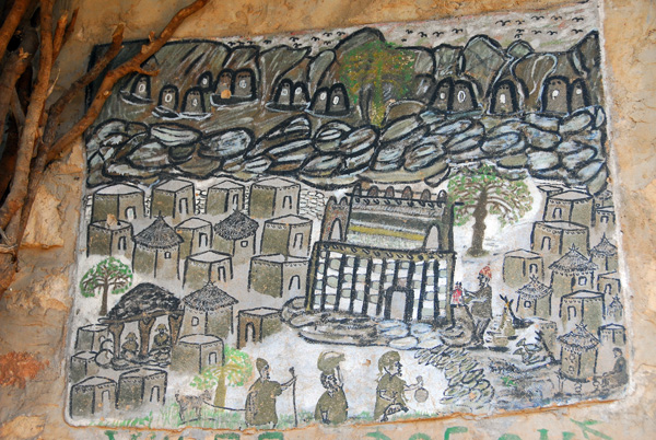Painting on a building in Tereli inviting tourists to visit the Hogon, the village spiritual leader