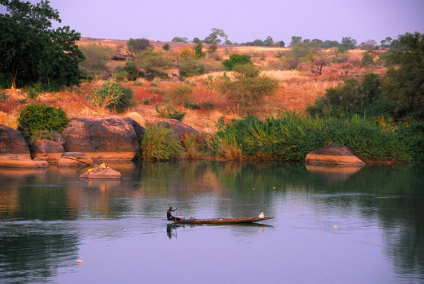 Fishing pirogue at dusk, Senegal River, Mali