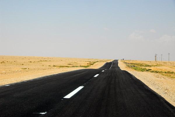 Blacktop road through the empty Syrian Desert