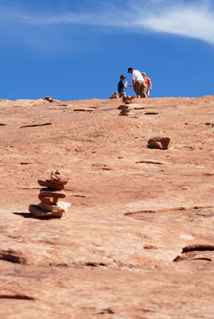 Cairns identify the Delicate Arch Trail on the blank sandstone