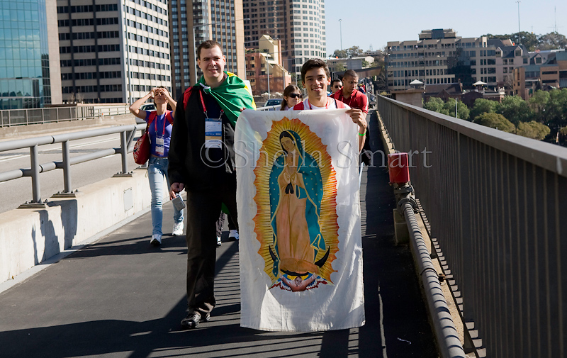 Young man with Virgin Mary flag